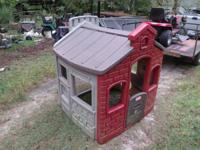This is a used plastic playhouse in good condition. You