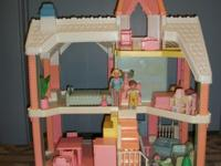 For sale is a playskool dollhouse with furniture and