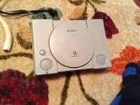 RARE model 1001 Playstation w/2 games and controller