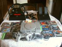 Playstation 1 with 53 games and Driving Set up shown,6