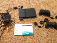 Playstation 2 slim in outstanding condition. All parts