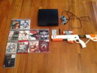 PS3 with controllers, cables, and the following games