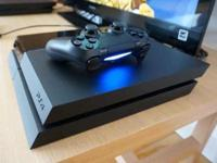 Barely Used PS4 (with retail Box) with 2 remotes &
