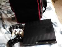 PlayStation 3, with carrying bag, two remotes, and two