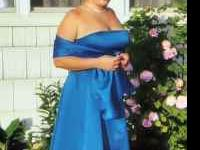 I have a gorgeous Faviana gown, size 19/20, which wears
