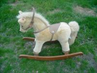 Plush tan rocking horse,makes clopping sound when you