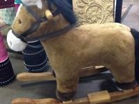 Sturdy, plush-covered horse on wooden rockers.