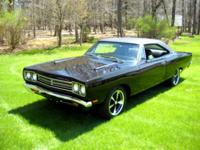 1969 Plymouth Roadrunner. The car is a triple black