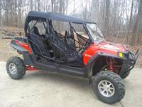 2012 Polaris RZR 4 900 XP. 4 seater. Red and black.