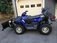 This is a pristine 2007 Polaris Sportsman 800. It has