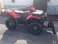 2012 Sportsman 500 4x4 with snow plow $5995. 2011