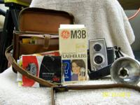 vintage Polaroid 360 camera complete with case. It has