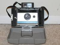 Great vintage Polaroid Land 210 camera.  It's in good