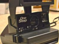 1 Black Polaroid One Step 600 Camera @ $20.00 a) Focus