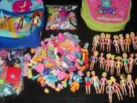 What we have here is a huge lot of polly pockets it is
