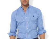 This crisp cotton poplin sport shirt is tailored for a