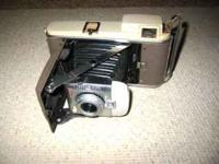PRICED SEPARATE: *Poloroid 250, $100 *Poloroid Land