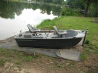 Used pond boat. 9ft long - 4ft wide about 14 in deep.