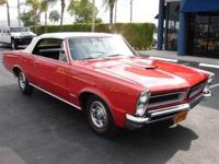 This 1965 Pontiac GTO Tri-Power Convertible features a