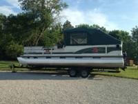1999 Tracker, 27 foot celebration barge with 2000