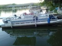 Pontoon boat 24' long with 70 HP Evinrude outboard, two