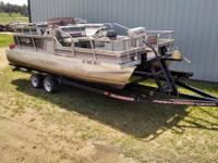 1990 20' Lowe Pontoon 1990 70 hp evinrude New Trailer