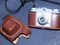 Camera with leather case in best condition. Includes