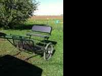 I am selling a small horse or pony cart. It is green