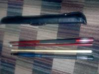 WE HAVE A PAIR OF POOL STICKS FOR SALE! - RED ONE IS AN