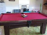 Pool Table in great condition with balls and pool