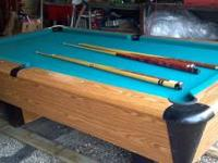 8' pool table with balls and 6 cue sticks. Made by