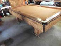 "8+ foot Pool Table. Has 1""solid slate top. Could use"