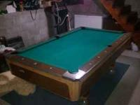 One piece slate top pool table in fantastic condition.