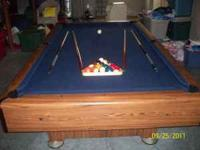 55 x100 inch pool table, includes cues, balls, etc.
