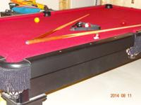 pool table - black with red felt- asking 850.00 dollars
