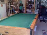 This is an excellent 8ft slate pool table with drop