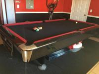 9' red and black Olio recreation pool table. This is