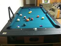 We're selling our 2-in-1 swivel pool table and air