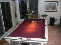 70's era pool table w/ ball return. Table was