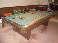 Top-Line brand name 8 foot regulation-size pool table.