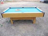 HAVE POOL TABLE AND BALLS FOR SALE ..100.00 good