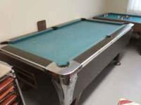 I have a 7 foot slate bed coin operated pool table for