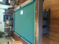 Pool table with wood pool cue holder (holding 10 pool