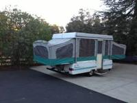 Pop up camper with queen bed and twin bed pullouts. 3