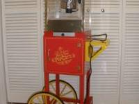 "This 48"" tall vendor-style popcorn cart is sure to be a"