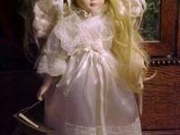 Angel Doll in an ivory gown with wings. She has