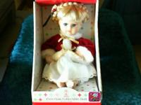 Collectible, darling little doll! Has blond hair in a