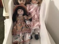 PRICE REDUCED!!! 3 Porcelain Dolls with Doll Bed...