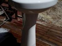 For sale is a pedestal ceramic/porcelain sink with