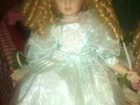 "This is a Kinnex 14"" porcelain doll comprehensive with"